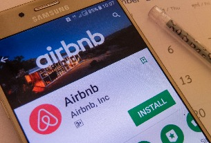 What happens to rate parity when Airbnb is an online travel agency?