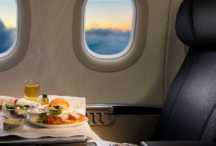 Will downsizing inflight meal service lead to airfare decrease?