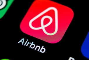 Airbnb's new $1 billion funding comes at lower valuation of $18 billion